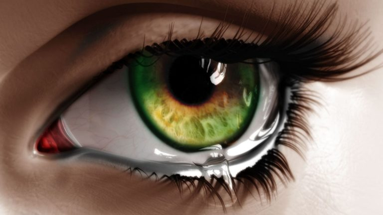 Green eye with tears HD wallpaper