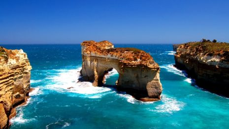Rocky natural arch in the ocean HD wallpaper