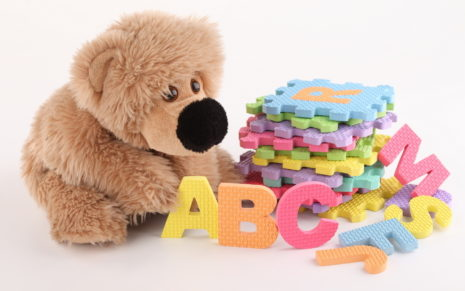 Stuffed bear playing with alphabets HD wallpaper