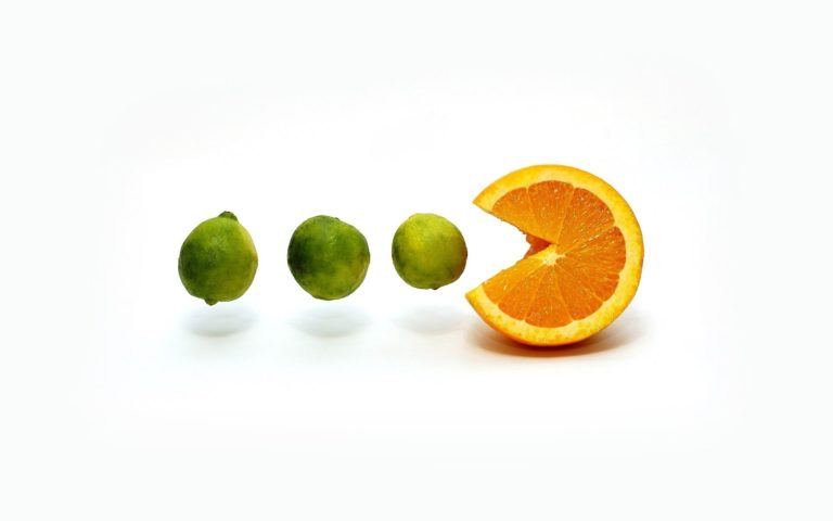 Limes and an orange HD wallpaper