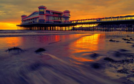 Pier bulding in the sunset HD wallpaper