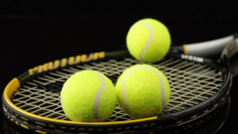 Tennis balls on Racket HD wallpaper