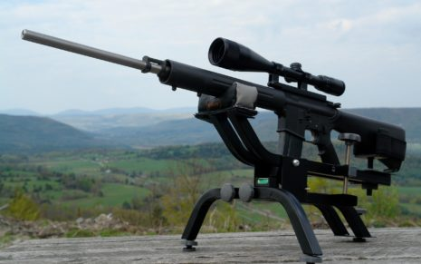 Black Sniper Rifle on stand HD wallpaper