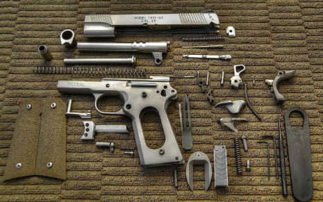 Disassembled M1911 pistol HD wallpaper