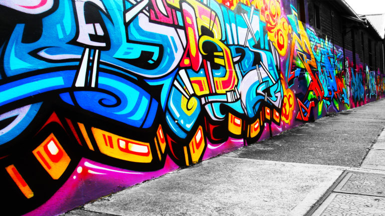 Graffiti filled wall HD wallpaper