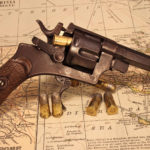 Revolver and bullets on map HD wallpaper