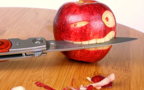 Apple with a knife HD wallpaper