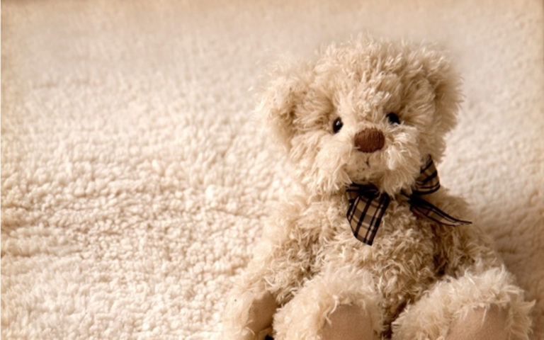 Teddy sitting on foam HD wallpaper