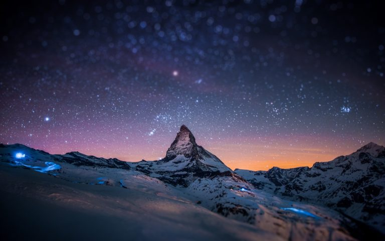 Night snow on mountain peak HD wallpaper