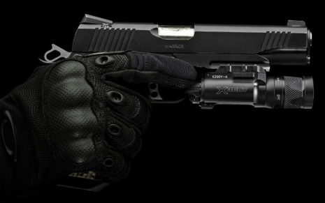 Pistol with protective gloves HD wallpaper