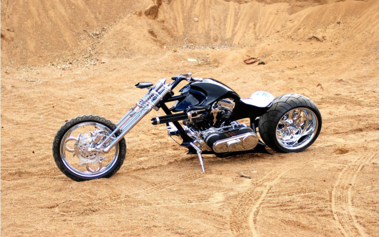 Black chopper in sand HD wallpaper
